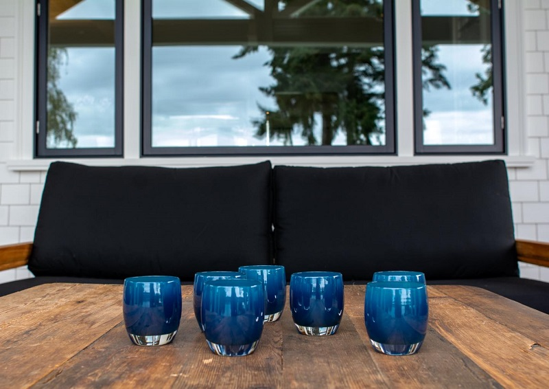 Glassybaby A Set of Blue Candle Holders on a Table Outside