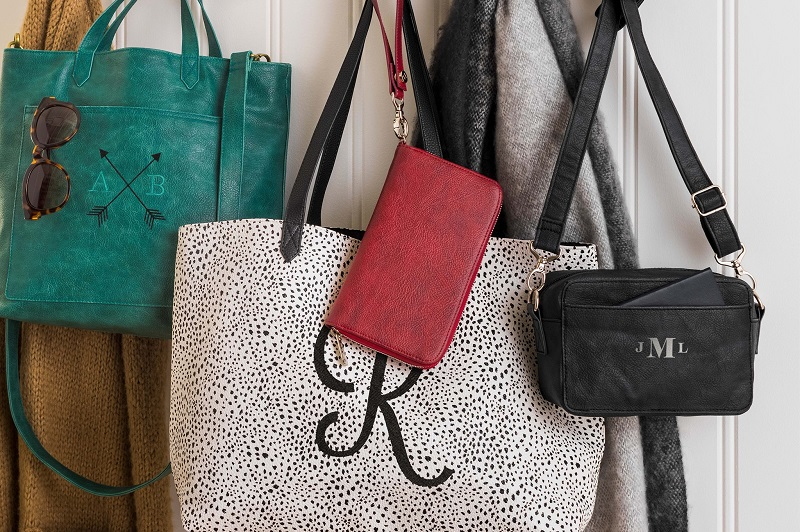 Thirty-One Gifts for Good Handbags Hanging from a Rack