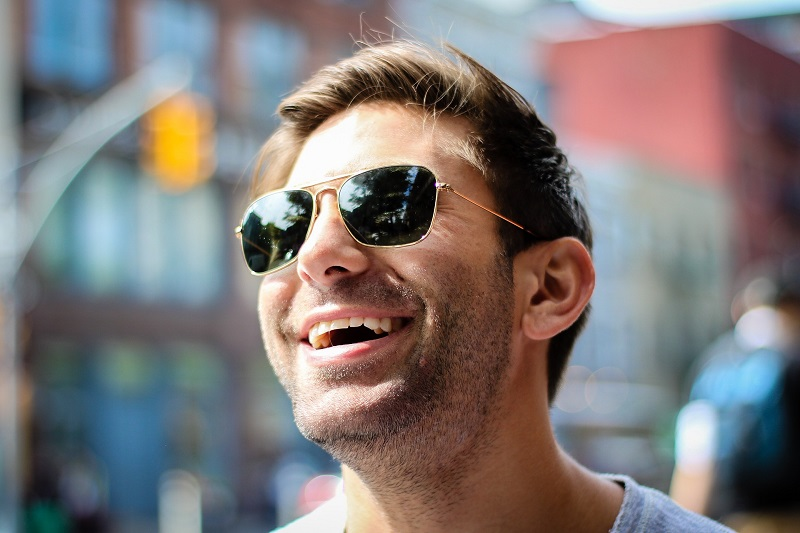 Why You Should Be Kind to Yourself Man Wearing Sunglasses and Smiling
