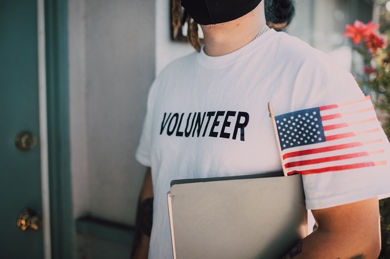 2021 Silver Seal of Transparency Volunteer Holding a Flag and a Clipboard