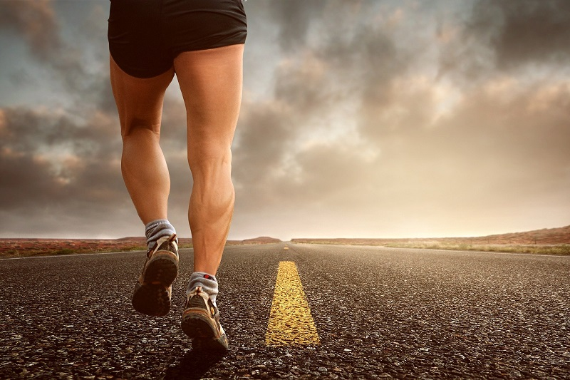 Running for Charity Miles Man's Legs as He Runs on a Street