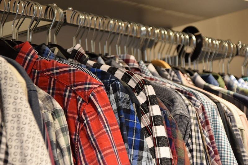 Good Deeds for Teens to Do During Summer Close Up of a Rack of Clothing