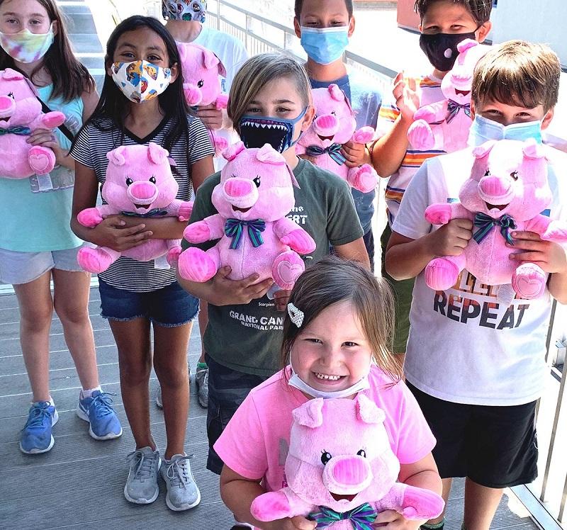 Extraordinary Lives Foundation Groupf Kids Holding a Stuffed Animal