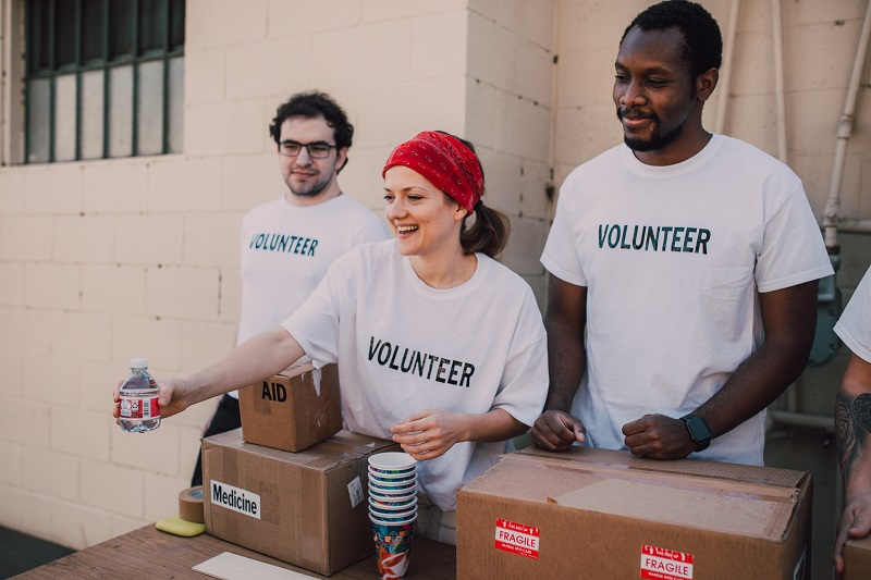 How Does Volunteering Make Someone a Better Leader a Group of People Wearing White Shirts That Say Volunteer
